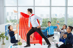 Manager in a red cape Royalty Free Stock Image