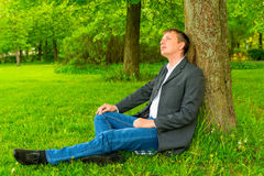 Manager relaxes in the park Royalty Free Stock Photography
