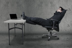 Manager relaxing on chair while daydreaming Royalty Free Stock Photos