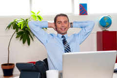Manager relaxing in his office, work break Stock Photo