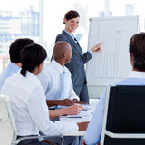 Manager reporting sales figures to her team Royalty Free Stock Photography