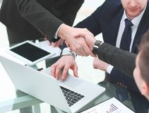 Manager`s and client`s handshakes over the Desk in the Bank`s office.  stock photography