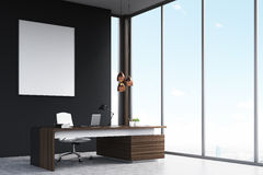 Manager`s office with a poster, side view Royalty Free Stock Photos