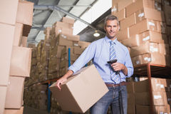 Manager scanning package in warehouse Royalty Free Stock Image