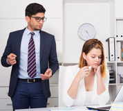 Manager scolding frustrated female Stock Photography