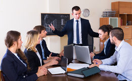Manager scolding his team severely during Stock Photography