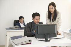 Manager and secretary consult for working in office desk. Manager and secretary consult for working in the office desk Royalty Free Stock Images