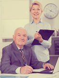 Manager and secretary working Royalty Free Stock Photography
