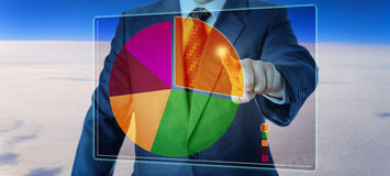 Manager Segmenting A Pie Chart High Above The Sky Stock Photography