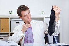 Manager selecting tie in office Royalty Free Stock Photo