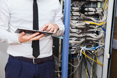 IT Manager in the server room. Internet service provider, server maintenance Stock Photography