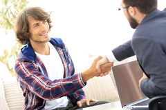Manager shakes hands with his client Royalty Free Stock Photography