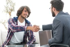 Manager shakes hands with his client Stock Photo