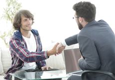 Manager shakes hands with his client. Agreeing with the terms of the transaction Stock Photo