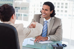 Manager shaking the hand of a female applicant Stock Image