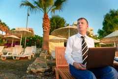 Manager in a shirt and tie on the beach Stock Photo