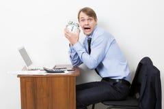 Manager shouts at the alarm clock Royalty Free Stock Photos