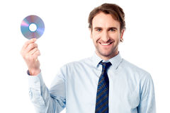 Manager showing compact disc Royalty Free Stock Images