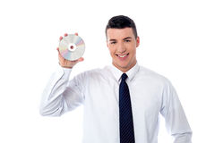 Manager showing compact disc Royalty Free Stock Photo