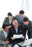 Manager showing document to his team Royalty Free Stock Images