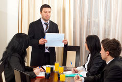 Manager showing financial graph at meeting Stock Photography