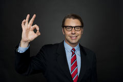 Manager showing okay sign to camera, good work Royalty Free Stock Images