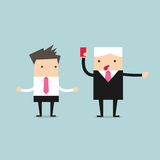 Manager showing a red card to businessman Stock Photo
