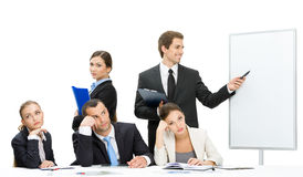 Manager showing something on screen to business people Stock Photo
