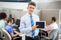 Manager Showing Tablet Computer In Call Center Royalty Free Stock Images