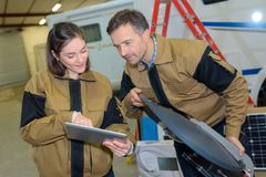 Manager showing tablet to worker in warehouse Royalty Free Stock Photos