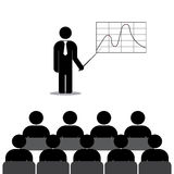 Manager shows a graph of employees Stock Images