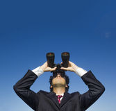 Manager with binoculars looks the sky Royalty Free Stock Images