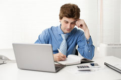 Manager sitting at desk in the office Stock Image