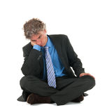 Manager sitting on floor Stock Images