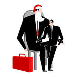 Manager sitting on lap of boss. leader Santa Claus congratulates Royalty Free Stock Photos