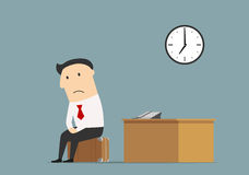 Manager sitting at office after being fired. Unemployment, jobless or professional crisis theme concept. Frustrated dismissed manager sitting on briefcase at Royalty Free Stock Image