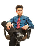 Manager sitting in office chair Royalty Free Stock Photography
