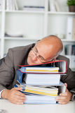 Manager sleeping on binders Royalty Free Stock Photos
