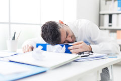 Manager sleeping on his desk Stock Images