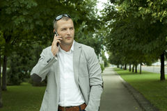 Manager with a Smart Phone. In the Nature Stock Images