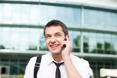 Manager speak on phone across office Royalty Free Stock Image