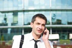 Manager speak on phone across office Stock Image