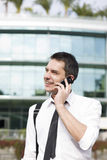 Manager speak on phone across office Royalty Free Stock Photography