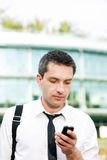 Manager speak on phone across office Stock Photos