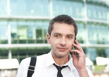 Manager speak on phone across office Royalty Free Stock Images