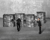 Manager speaker yelling businessman pushing jigsaw puzzle concre Royalty Free Stock Image