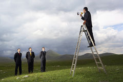 Manager Speaking Through Megaphone To Businessmen Royalty Free Stock Photography