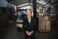 Manager standing in front of her employee Stock Images