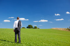 Manager standing under a blue sky Stock Photo