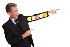 Manager with sticky notes on arm Royalty Free Stock Photos